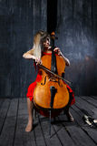 Beautiful cello musician royalty free stock images