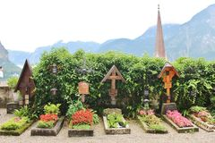 Beautiful cemetery in Hallstatt, Austria. Hallstatt is a small Austrian municipality at Hallstätter See in the state of Upper Austria. Main industries are stock photo