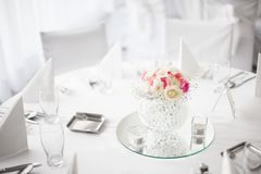 Beautiful centerpiece flower decoration on dining table Stock Image