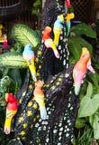Beautiful ceramic bird clinging. Royalty Free Stock Photos