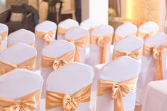 Beautiful chairs decoration with ribbon in wedding event hall,se Royalty Free Stock Photography