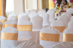 Beautiful chairs decoration with ribbon in wedding event hall,se Stock Images