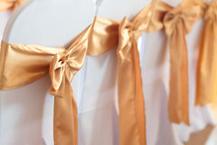 Beautiful chairs decoration with ribbon in wedding event hall,se Royalty Free Stock Images