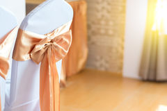 Beautiful chairs decoration with ribbon in wedding event Stock Photography