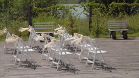 Beautiful chairs with ribbons at the wedding reception.