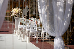 Beautiful chairs at the wedding ceremony. Beautiful chairs at the wedding ceremony outdoors Stock Image