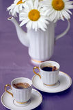 Beautiful chamomile and cup of coffee Royalty Free Stock Photography