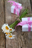 Beautiful chamomiles and gifts Royalty Free Stock Images