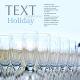 Beautiful champagne glasses. Over blurred background.Copy space Royalty Free Stock Photography