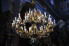 Beautiful chandelier with candles in church Royalty Free Stock Image