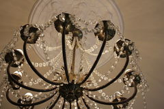 A beautiful chandelier in the Clocks museum. Royalty Free Stock Images