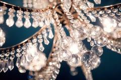 Beautiful chandelier glitters. Beautiful chandelier in the bar Stock Photo
