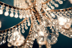 Beautiful chandelier glitters. Beautiful chandelier in the bar Royalty Free Stock Images
