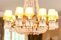 Beautiful chandelier in interior of living room royalty free stock photography