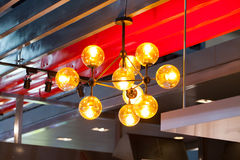 Beautiful chandelier. luxury expensive chandelier hanging under Stock Photo