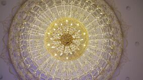 A beautiful Chandelier at a Restaurant. Could also be the Interior of a classy Bar or a Living Room.