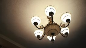 Beautiful chandelier in the room stock footage