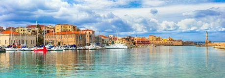 Beautiful Greece series - picturesque old town of Chania. Crete. Beautiful Chania town,view with colorful houses,yachtsand lighthouse,Crete island,Greece royalty free stock images