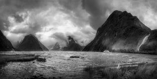 Beautiful Chaos at Milford Sound. Dramatic weather conditions at Milford Sound in black and white, view at Freshwater Basin towards the fjord`s entry, with Bowen Royalty Free Stock Photography