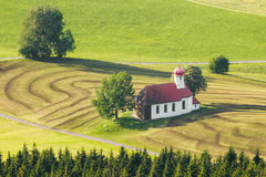 Beautiful chapel in lovely rural countryside. Pasture landscape with meadows and trees. Beautiful bavarian chapel in lovely rural countryside. Pasture landscape Stock Images