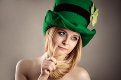 Beautiful charming blond girl in leprechaun image isolated on gray background Royalty Free Stock Photography