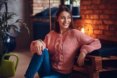 A beautiful charming brunette in a room with loft interior. Royalty Free Stock Images