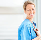 Beautiful charming doctor in blue uniform smiling Stock Images
