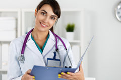 Beautiful charming friendly smiling female medicine therapeutist Royalty Free Stock Images