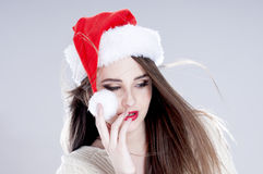 Beautiful charming girl wearing  santa hat. Stock Photo