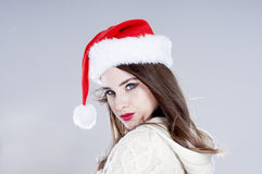 Beautiful charming girl wearing  santa hat. Royalty Free Stock Image