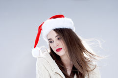 Beautiful charming girl wearing  santa hat. Royalty Free Stock Images