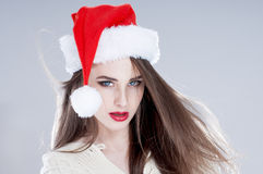 Beautiful charming girl wearing  santa hat. Stock Photography