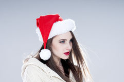 Beautiful charming girl wearing  santa hat. Royalty Free Stock Image