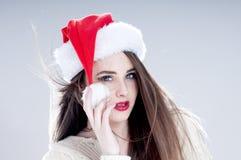 Beautiful charming girl wearing  santa hat. Stock Images