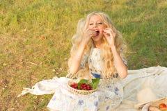 Beautiful charming long curly blonde hair teenage girl wearing a royalty free stock photo