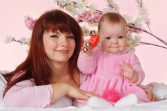 Beautiful charming mother and daughter Royalty Free Stock Photos