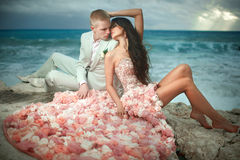 Beautiful, charming and sexy couple kissing on rocks, cliffs dur Royalty Free Stock Photo