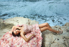 Beautiful, charming and woman, model lying on rocks, cliffs Royalty Free Stock Photography