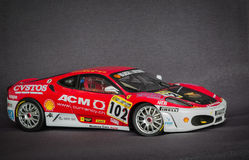 Beautiful charming view of Ferrari race sport miniature car model against dark grey background Stock Image