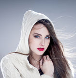 Beautiful charming woman in hood Royalty Free Stock Photo