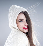 Beautiful charming woman in  knitted  hood. Royalty Free Stock Images