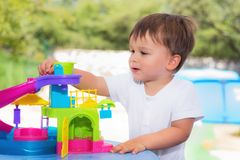 Cheerful baby playing outdoor royalty free stock image