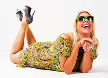 Beautiful cheerful blonde in green sunglasses Stock Photo