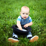 Beautiful cheerful boy with black hat in summer park Stock Photography
