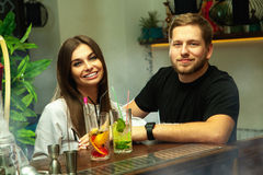 Beautiful cheerful couple at the bar Royalty Free Stock Photos