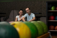 Beautiful Cheerful Couple Talking At The Bowling Alley Stock Image