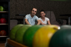 Beautiful Cheerful Couple Talking At The Bowling Alley Stock Photography