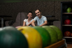 Beautiful Cheerful Couple Talking At The Bowling Alley Royalty Free Stock Image