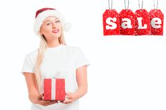 Christmas girl in Santa`s hat with gi stock photos