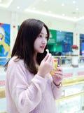 Beautiful cheerful girl eat ice cream Royalty Free Stock Photos